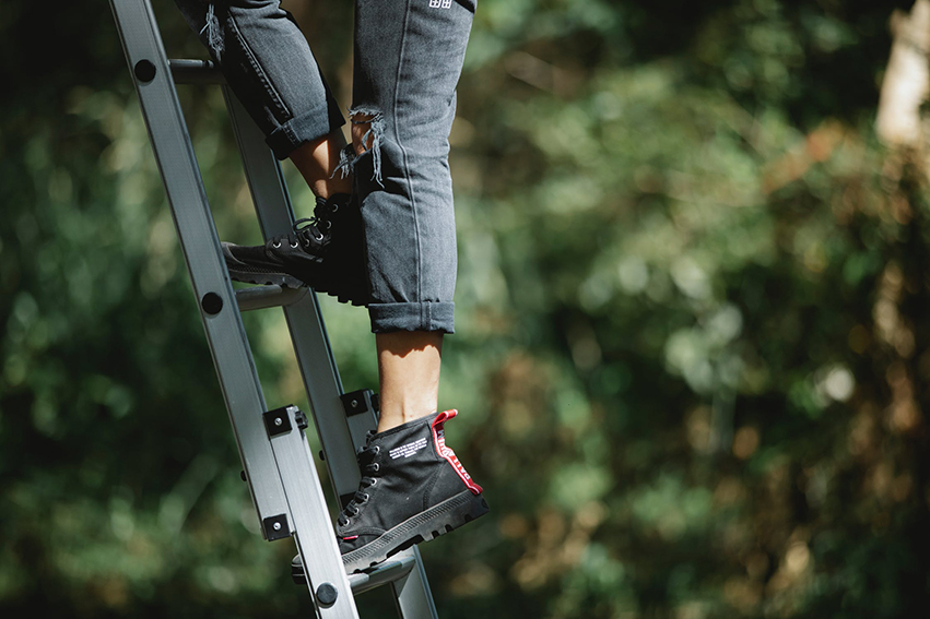 person climbing ladder